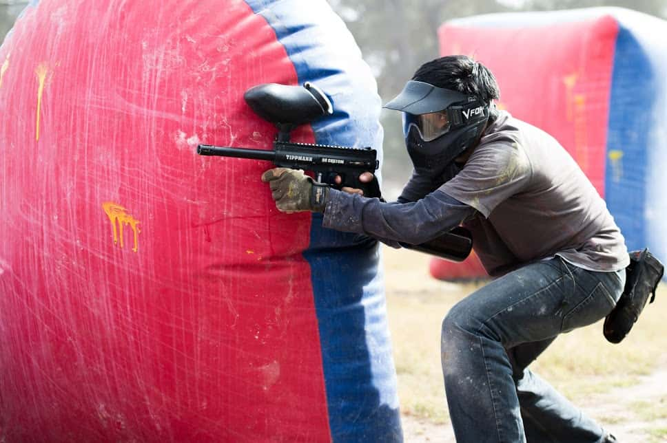 paintball player behind bunker at Austin Paintball