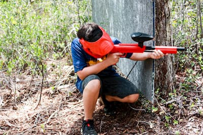 young paintball player on Destin woods field