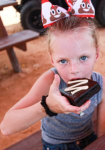 girl with cupcake at paintball birthday party near destin