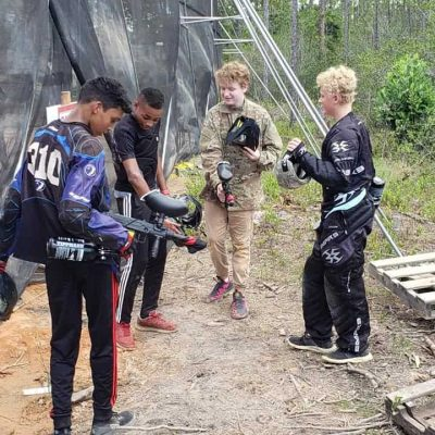 four boys on paintball field near destin FL